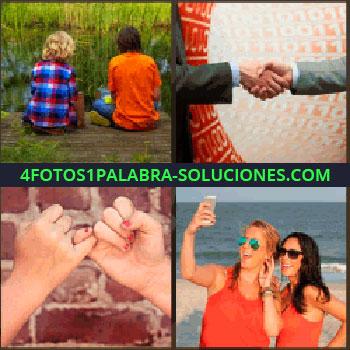 4 Fotos 1 Palabra - Niños sentados junto a un río, hombres con traje dándose la mano, dos manos unidas por los dedos meñiques, mujeres de rojo, selfie amigas