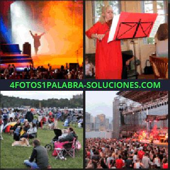 4 Fotos 1 Palabra - Escenario con luces anaranjadas, gente sentada en el césped, concierto al aire libre, mujer de rojo con violín